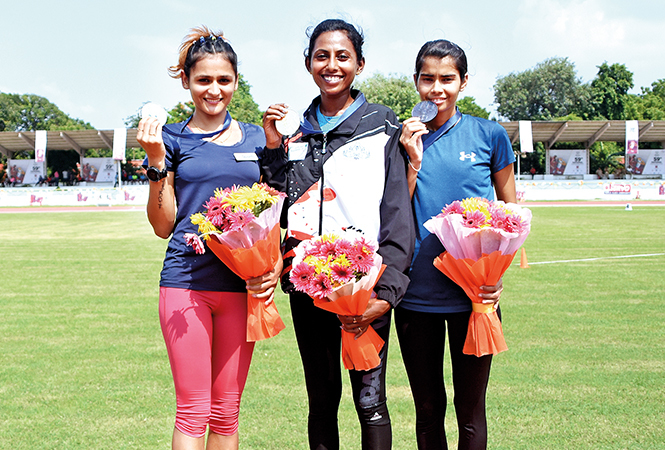 (L-R) Priyanka Goswami, Soumya B and Sonal Sukhwal, winners of the 20 km walk event (BCCL/  Farhan Ahmad Siddiqui)