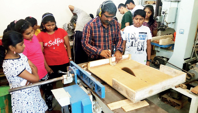 Artist Sanjay Yamgar teaching kids carpentry