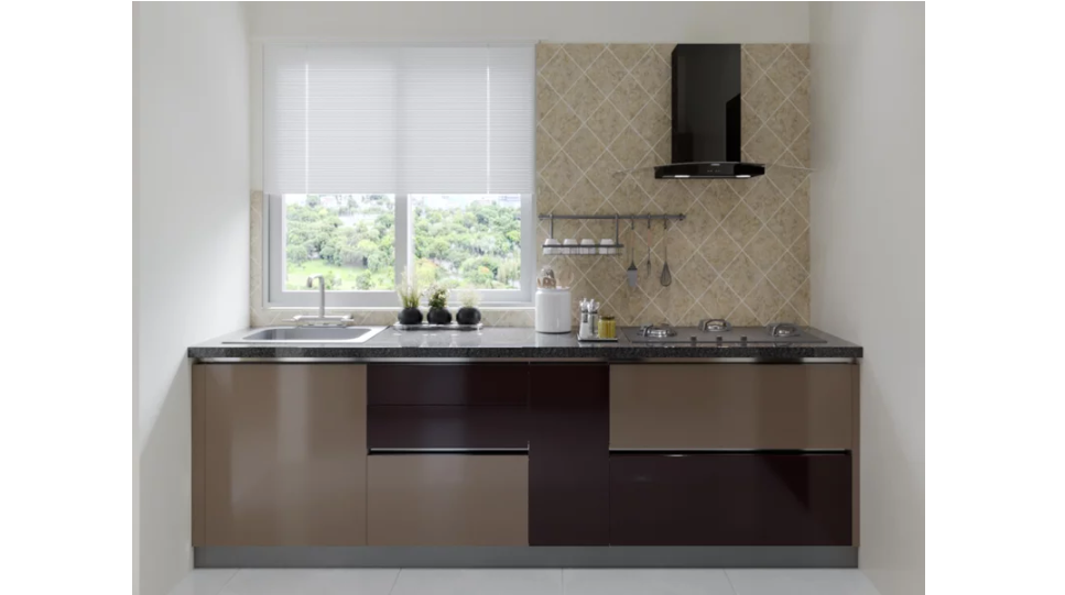 A kitchen with a window setting
