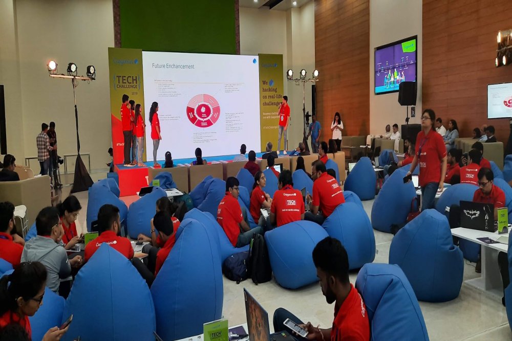 A participating team presenting their tech solution to jury members and other participants at Tech Challenge 2019