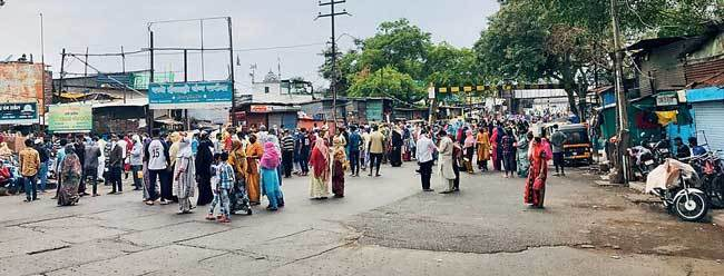 Thousands converged at the PMC ration distribution location in Mangalwar Peth on Friday, as shops in their area are shut and they have no other option left; reportedly, people from neighbouring slums also gathered at the spot