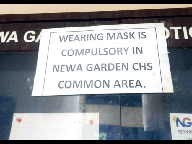 A sign lays down the law at a Navi Mumbai complex where rules are being enforced selectively