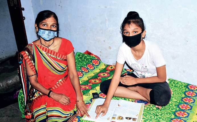 Bhumika studies on her own. Mom Kailashben someimes helps her