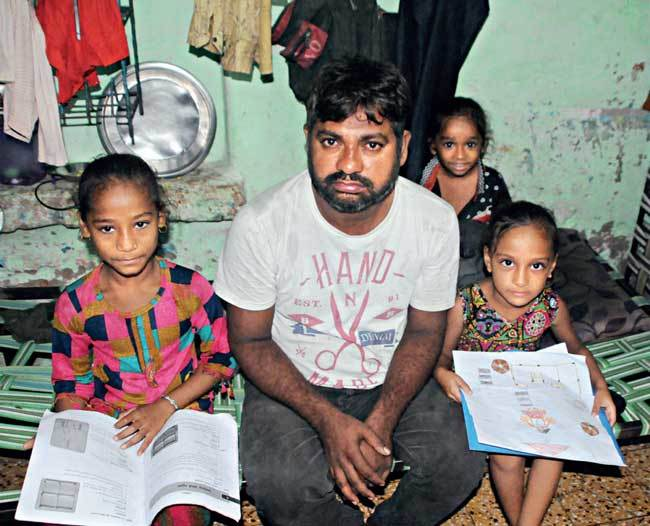 Lakshman Vaghela cannot afford smartphone for his daughters Tanya, 9, and Tamanna, 7