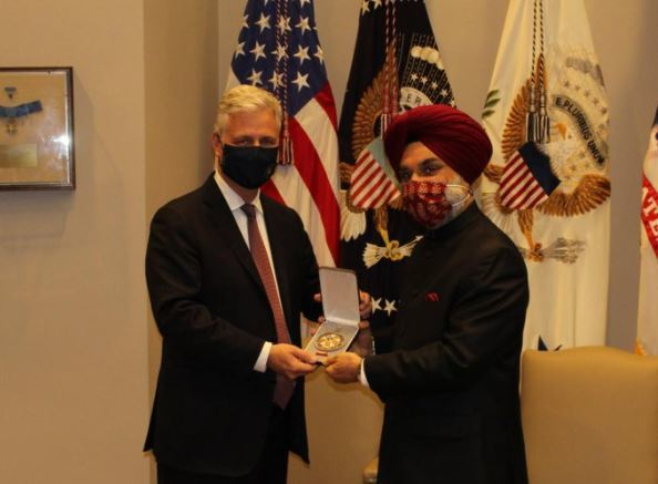 Indian Ambassador to US Taranjit Singh Sandhu accepting the medal on behalf of PM Modi. (ANI)