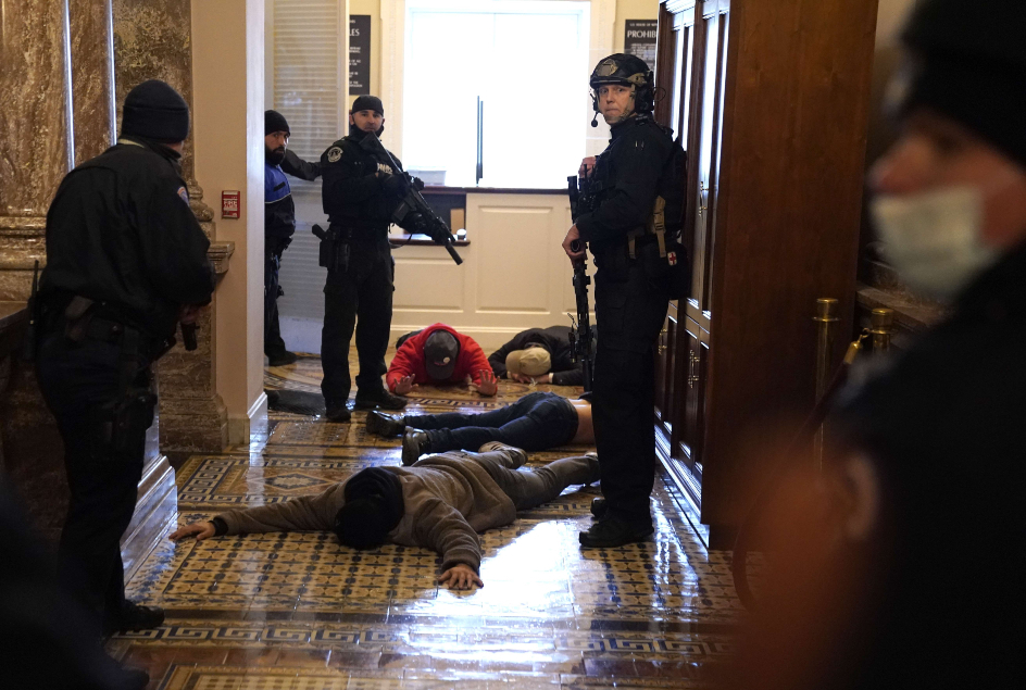 U.S. Capitol Police stand detain protesters outside of the House Chamber AFP 635