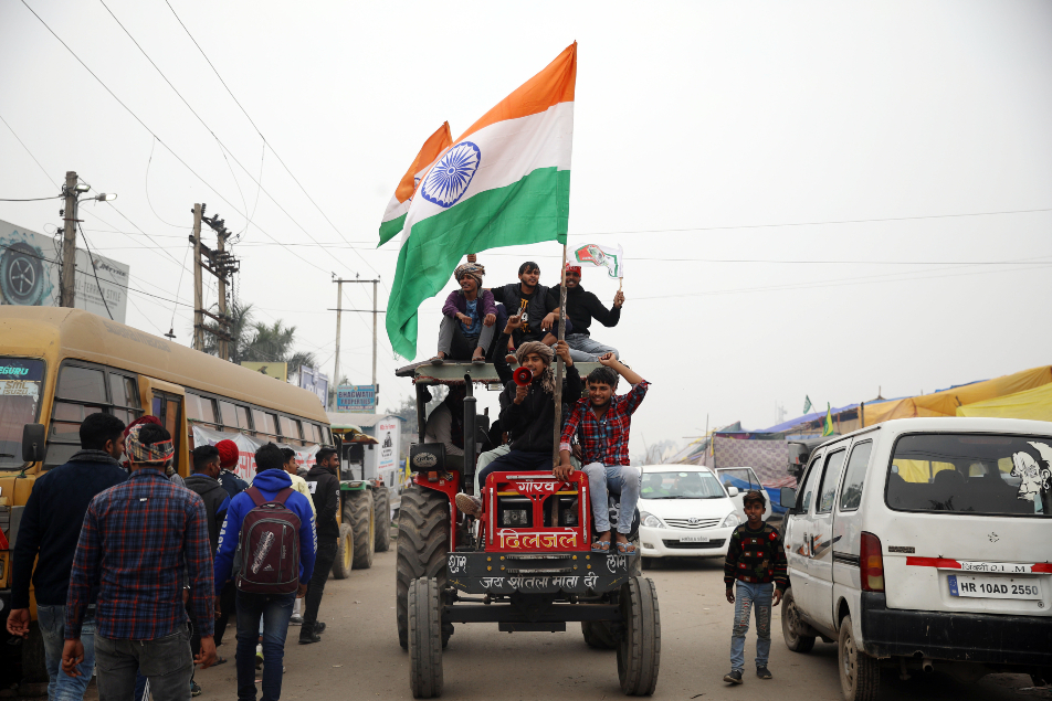 Farmers ride tractors as they shout slogans during an ongoing protest ANI 635