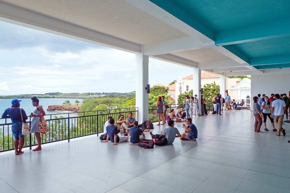 Students relax in the open air of Modical Hall