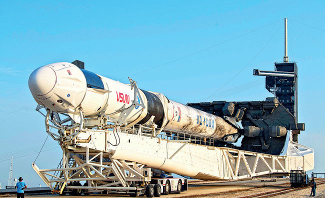 A SpaceX Falcon 9 rocket with the company's Crew Dragon spacecraft is rolled to Launch Complex 39A as preparations continue for the Crew-2 mission at NASA's Kennedy Space Center at Cape Canaveral, Florida; PIC: AUBREY GEMIGNANI/NASA VIA AP