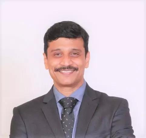 Dr. Dinesh (1).
