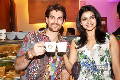 Prachi, Neil @ coffee shop launch