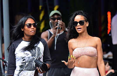 Rihanna goes braless, flashes nipples!