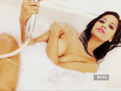 Poonam in a bath tub