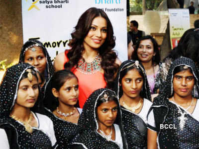 Bipasha Basu with school kids