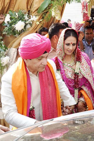 Akshay Kumar's sister Alka Bhatia with her groom Surendra Hiranandani during their wedding ceremony, held at Four Bungalow Gurudwara in Mumbai on December 23, 2012.