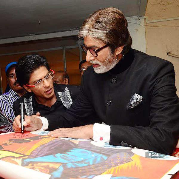 Big B signs autograph for SRK
