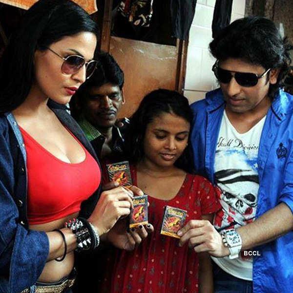 Veena distributes condom