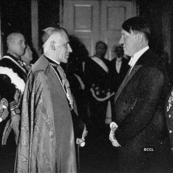 Adolf Hitler met Pope Pius XI whose reign began with the rise