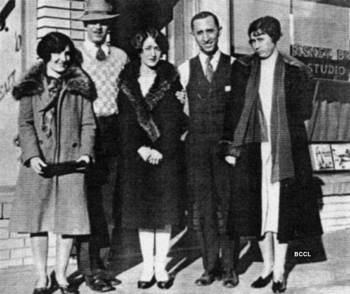 Roy O. and Walt Disney with their wives