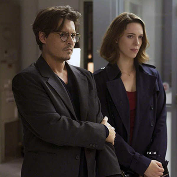 Johnny Depp in his late forties and Rebecca Hall in her late thirties