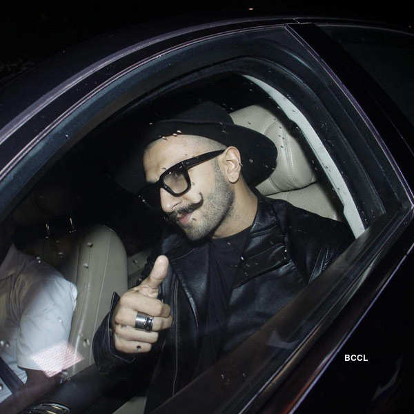 Ranveer Singh gestures as he arrives for the birthday party