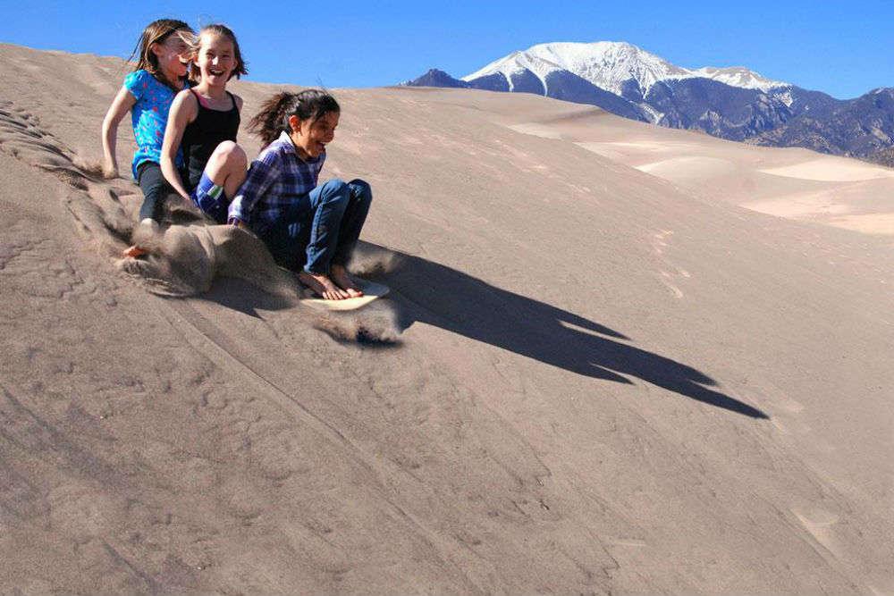 Sandboard down Sand Mountain