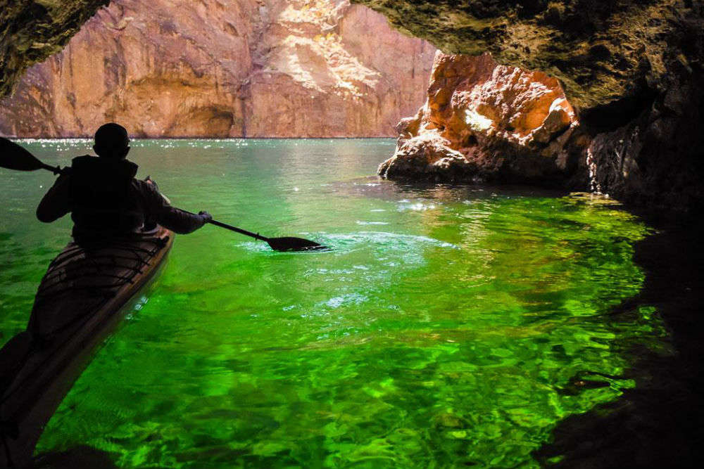 Kayak over emerald-colored water