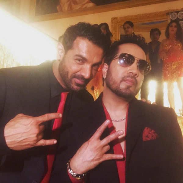 John Abraham poses with singer Mika Singh