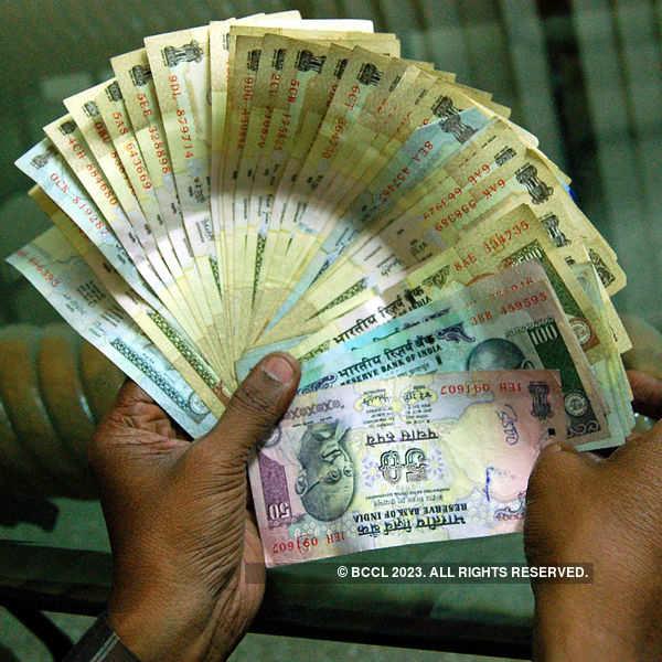Rupee down on strong dollar demand