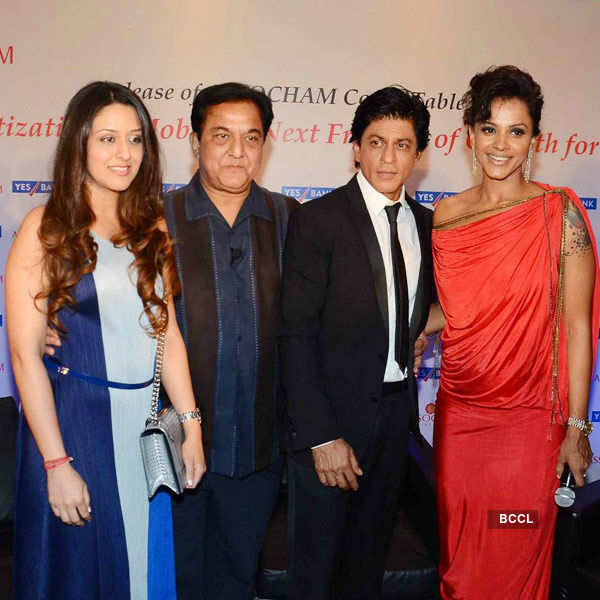 SRK unveils ASSOCHAM coffee table book