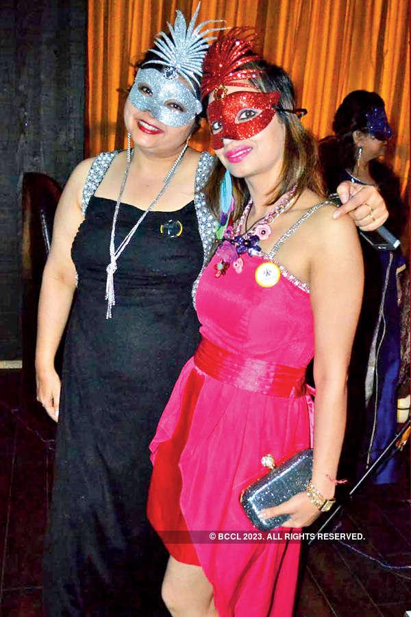 Socialites at masquerade party