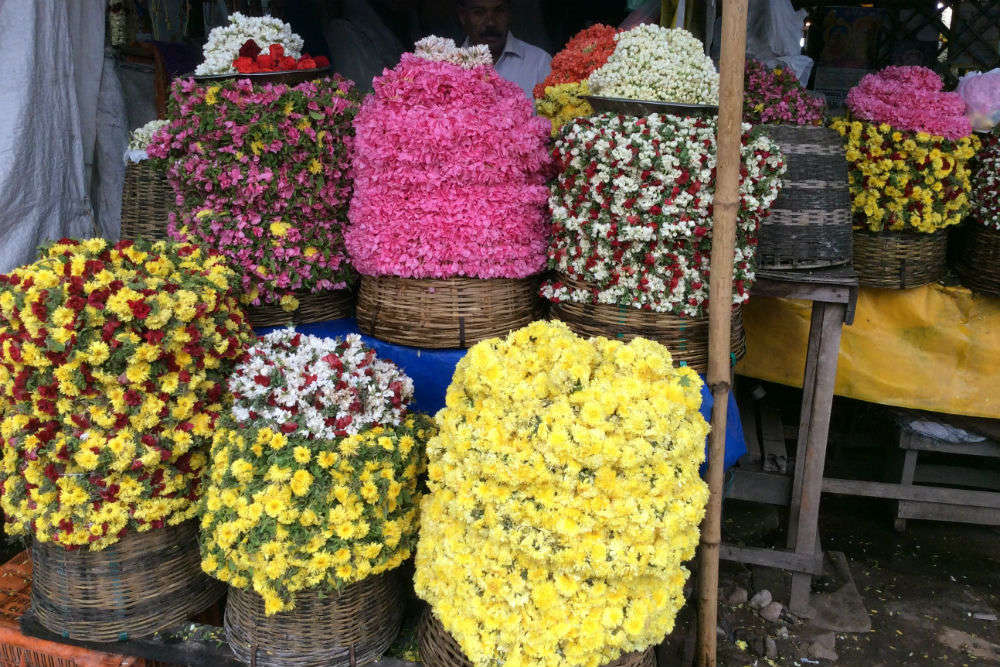 Visit the local flower and vegetable markets