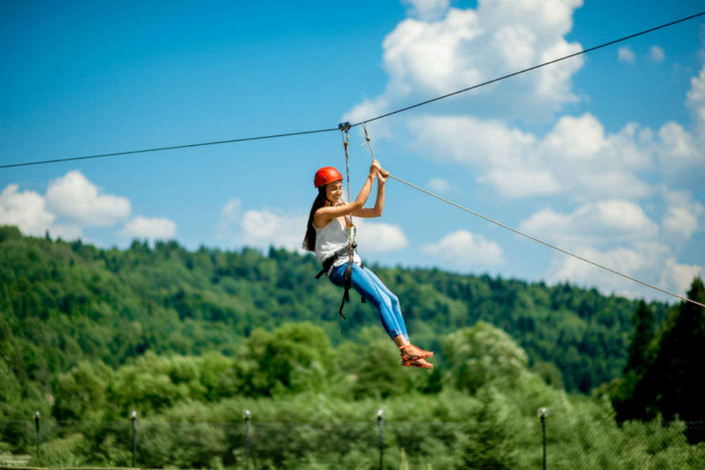 Jump through the trees and fly on a zip line