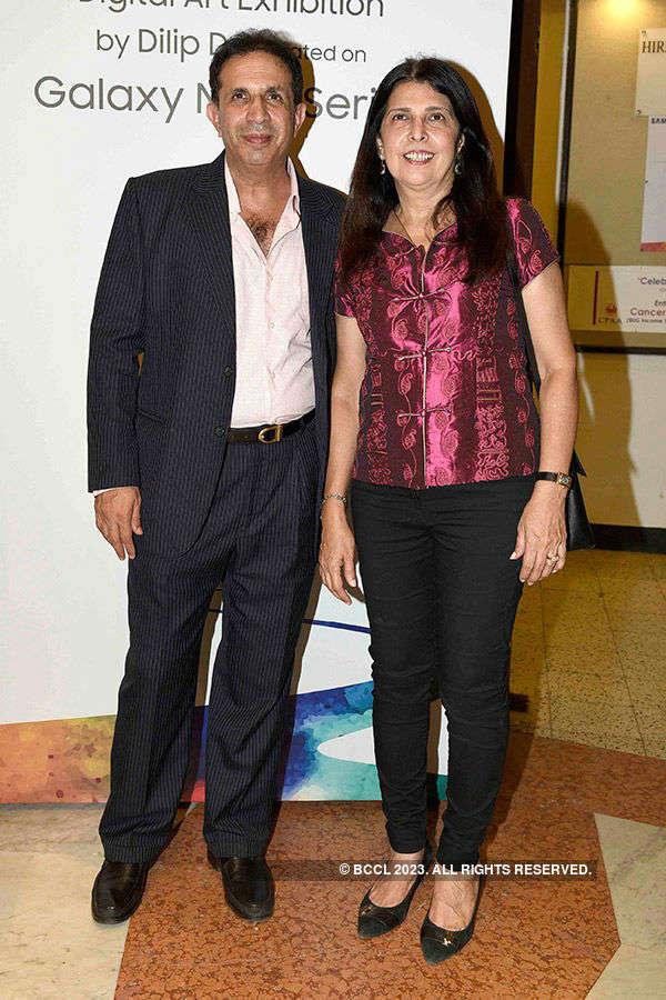 Big B launches Dilip De's art exhibition