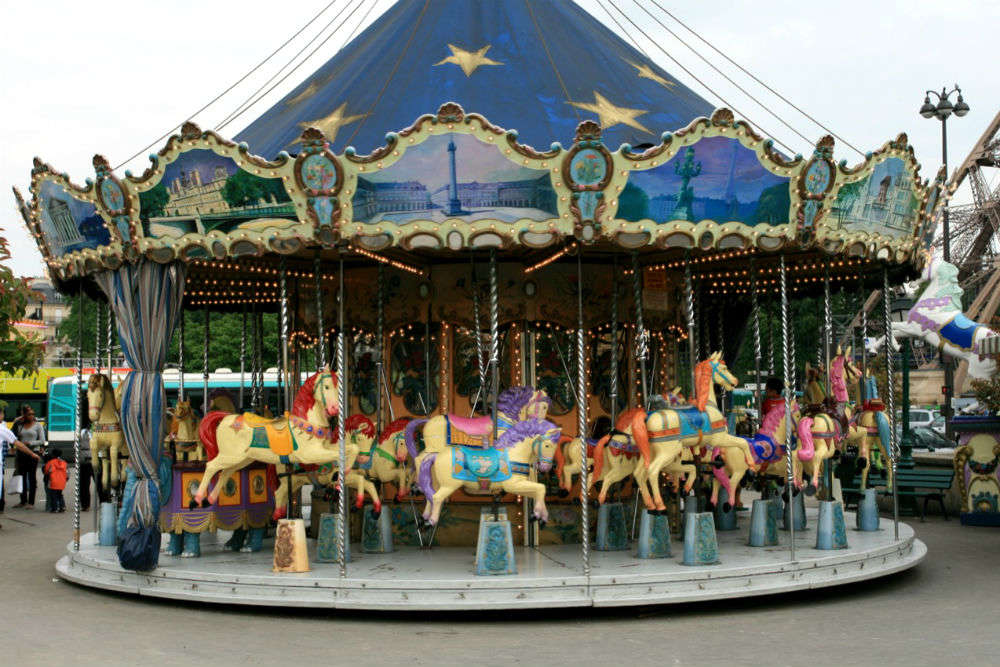 Let your kids ride one of the 20 free carousels around Paris