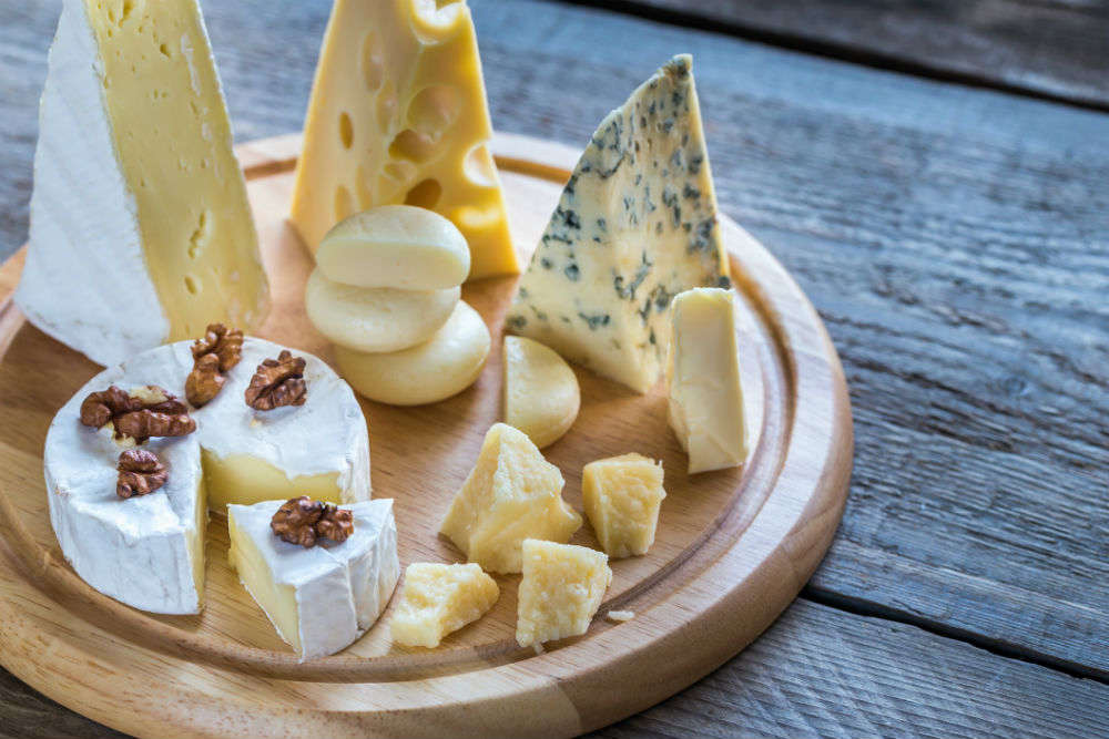 Visit a cheese cellar and learn about Swiss Cheese