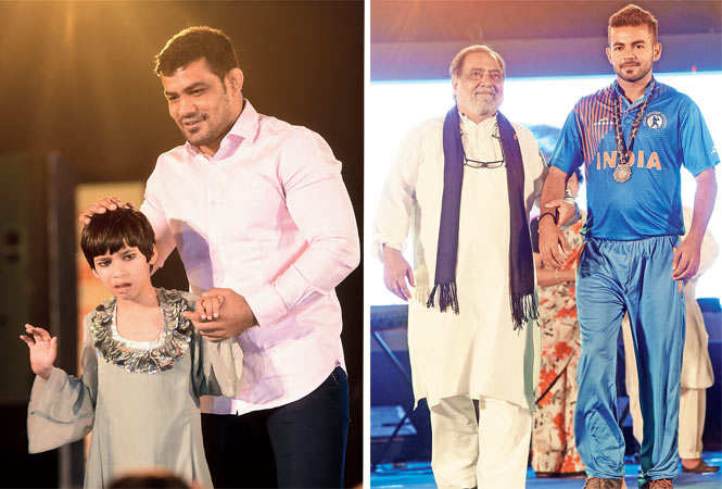 (L-R)Sushil Kumar was one of the celebs who walked the ramp at this show and Aamir Raza Hussain with hearing-impaired cricketer Vaibhav(BCCL)