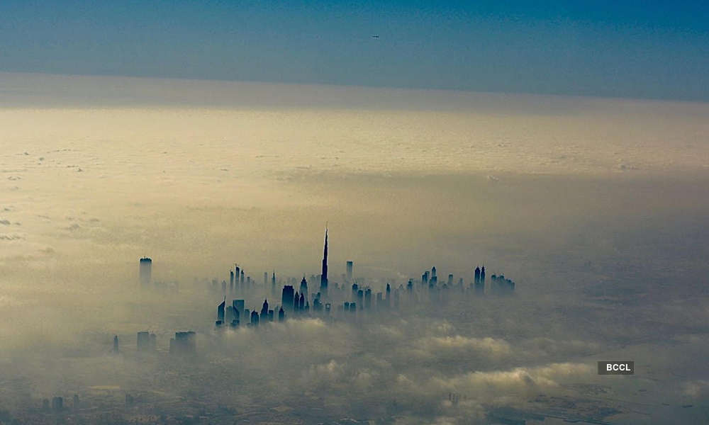Breathtaking photos of Burj Khalifa undeterred by the fog, through a pilot's lens.