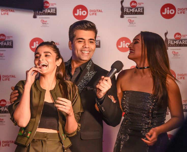 Sonakshi Sinha, Alia Bhatt and Karan Johar having a light moment