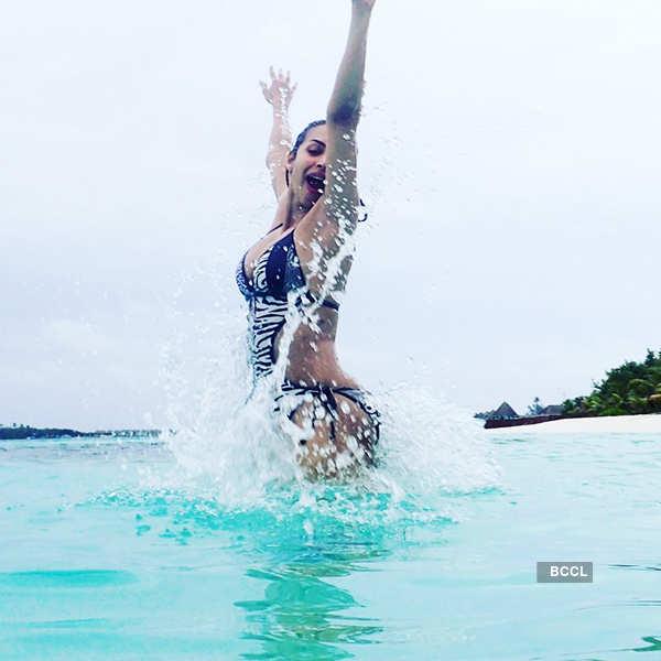 Beach babe Malaika Arora turns on the heat!