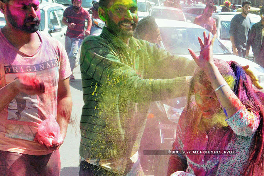 Photos: Holi revelry takes happy, ugly hues
