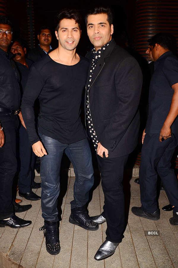 Varun Dhawan and Karan Johar attend the success party