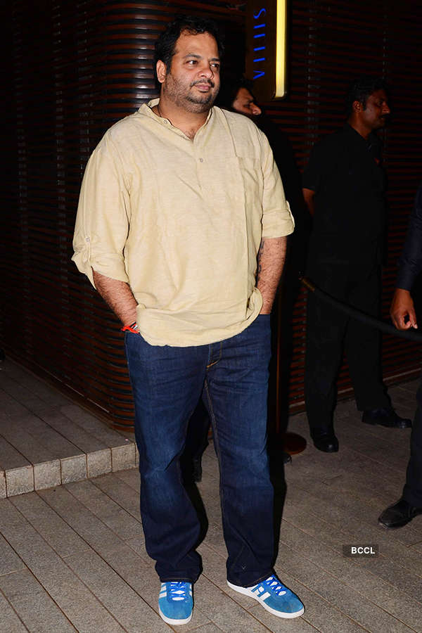 A guest attends the success party