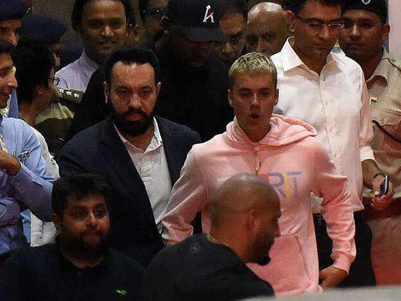 Salman Khan's bodyguard Shera escorts Justin Bieber as he arrives in Mumbai