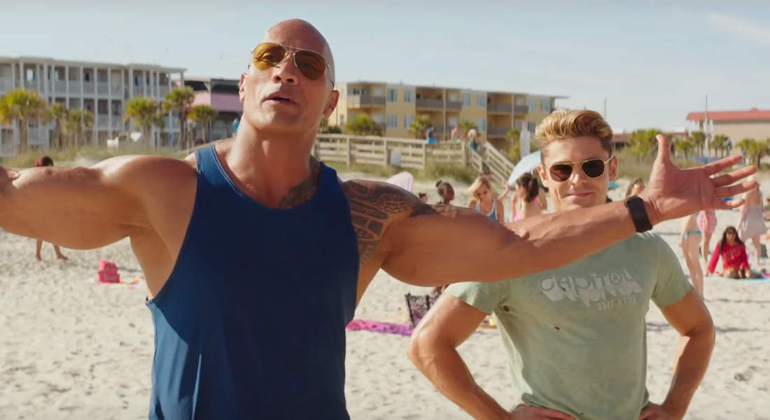 Dwayne Johnson and Zac Efron at beach