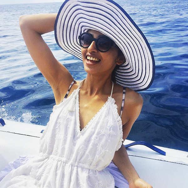 Radhika Apte beats the heat in style, chills poolside!