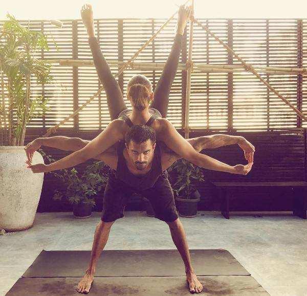 Bipasha with her husband Karan practice yoga