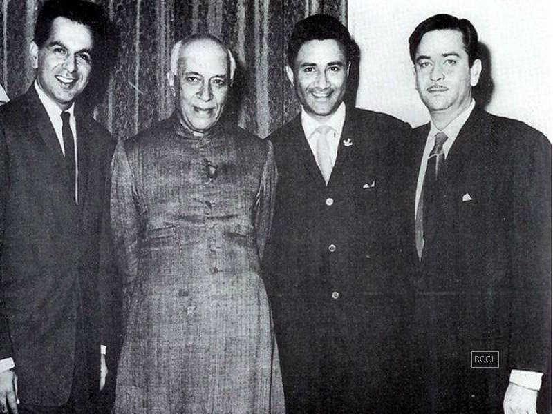 Dilip Kumar, Raj Kapoor, and Dev Anand strike a pose with Pandit Jawaharlal Nehru