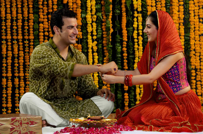 A sister ties rakhi on her brother's wrist during this festival