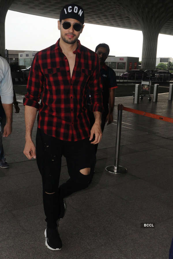 Photos of celebrities at airport